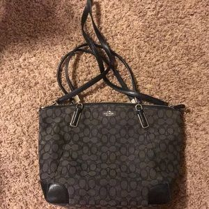Black canvas coach purse
